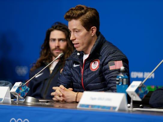 Feb 5, 2014; Sochi, RUSSIA; Danny Davis (left) listens to Shaun White during the USA Snowboarding Halfpipe Press Conference at Gorki Media Center.  Mandatory Credit: Andrew P. Scott-USA TODAY Sports
