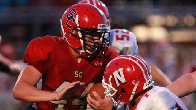 Spencer/Columbus Hunter Luepke, left, and the Rockets entered The Associated Press this week as the No. 10 team in the Medium Division. The Rockets are 3-0.