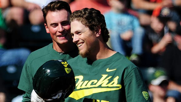 Oregon's Phil Craig-St. Louis celebrates with teammates after hitting a three-run home run against Oregon State at PK Park, on Sunday, April 12, 2015, in Eugene. Oregon won the game 10-9.