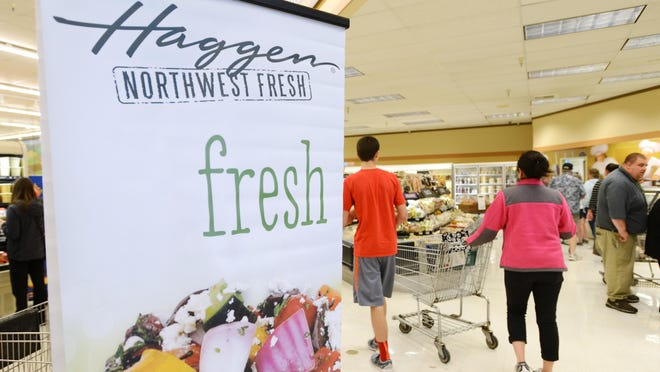 Customers arrive at Haggen grocery store during the opening on April 28, in Keizer.