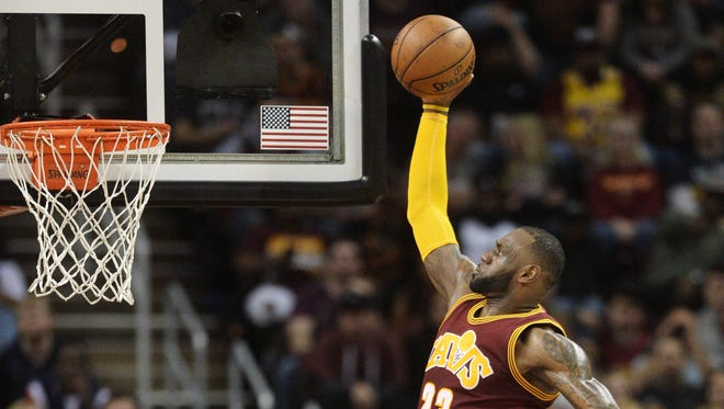 Cleveland Cavaliers forward LeBron James (23) moves to the basket during the first half against the New York Knicks at Quicken Loans Arena.