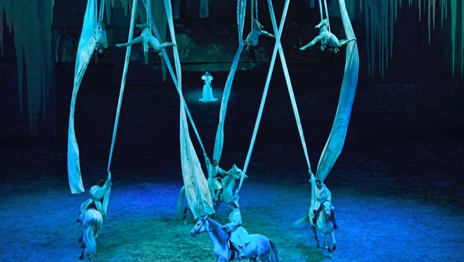 """""""Les Anges"""" creates an ethereal scene with aerial artists suspended by flowing silks as horses move in perfect harmony below in """"Odysseo."""""""