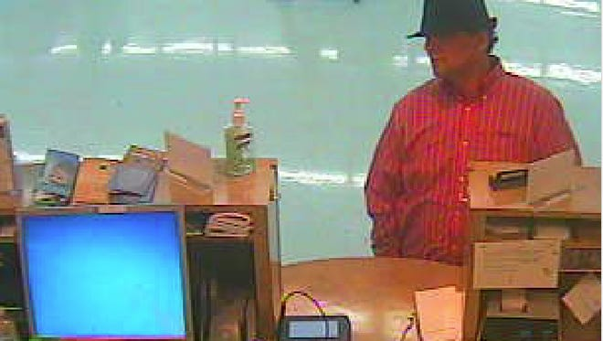 Deputies are looking for the man in this surveillance photo in connection with a bank robbery in Henrietta Wednesday.