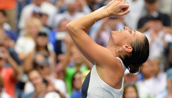 Flavia Pennetta of Italy celebrates after beating Roberta Vinci of Italy in the women's singles final during the U.S. Open on Sept. 12, 2015.