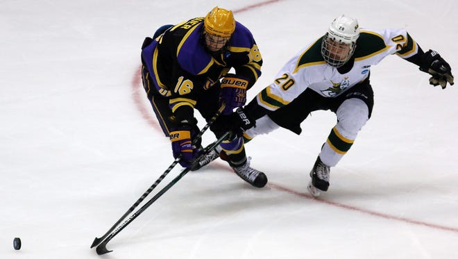 St. Norbert College forward Steven Phillips battles UW-Stevens Point's Eliot Grauer for control of the puck during the NCAA Division III national championship game in March at Lake Placid, N.Y. The Green Knights enter the season ranked No. 2 behind the top-ranked Pointers.