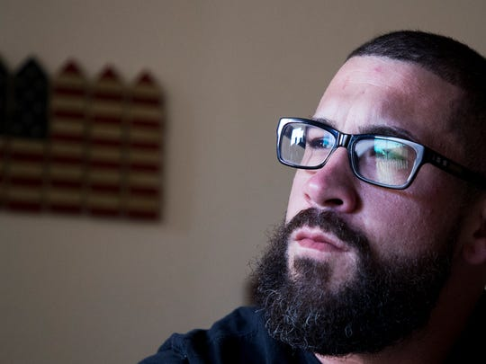 John McLellan, 30,an Afghanistan and Iraq War veteran, voted for Donald Trump but has been skeptical of his abilities as a Commander in Chief.