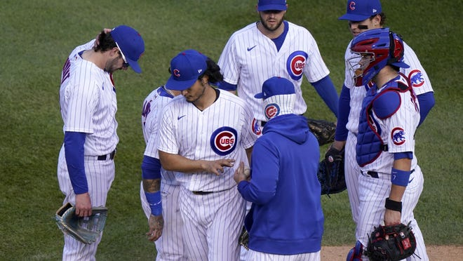Chicago Cubs' Yu Darvish is removed by manager David Ross during the seventh inning in Game 2 of a National League wild-card baseball series Friday, Oct. 2, 2020, in Chicago.