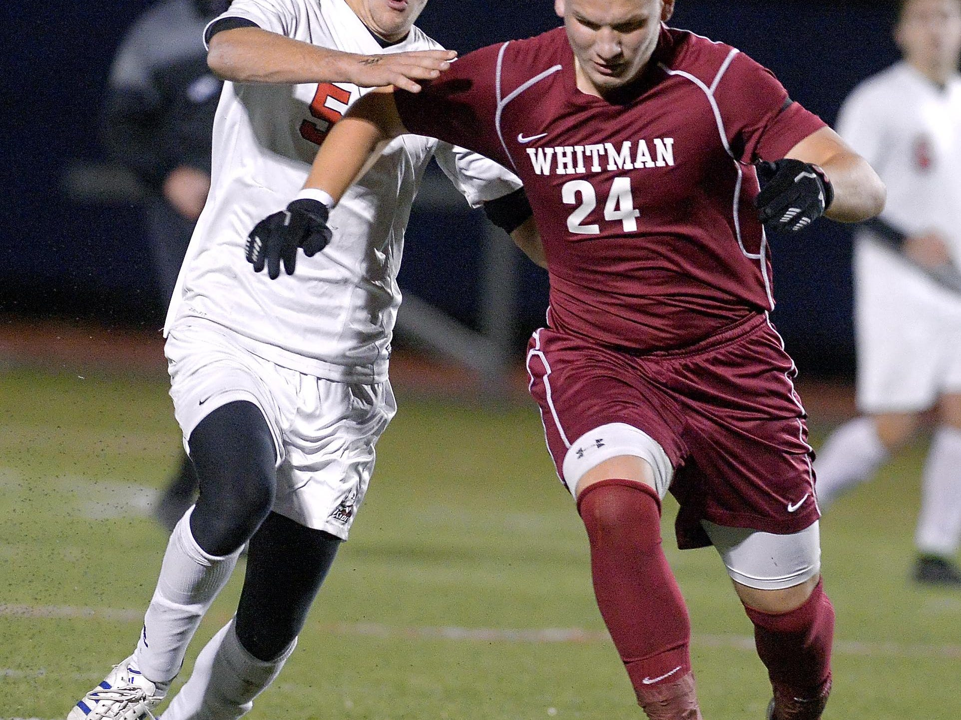 Hilton's Jeff Hibbard, left, battles for the ball against Walt Whitman's Sean Zagorski during a NYSPHSAA Boys Soccer Championships Class AA semifinal played at Middletown High School on Saturday, November 14, 2015. Hilton's season ended with a 7-3 loss to Walt Whitman-XI.