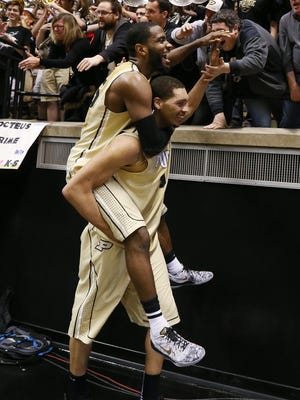Purdue Boilermakers center A.J. Hammons gives teammate Rapheal Davis a ride on his back around fans after defeating Indiana earlier this season. The two rivals will only meet once next year.