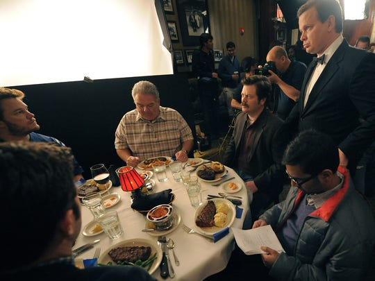 "Male cast members of ""Parks and Recreation"" prepare to shoot a scene at St. Elmo Steak House."