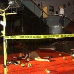 """Audience members walk past a display while attending """"Behind the Scenes of CSI: Crime Scene Investigation"""""""