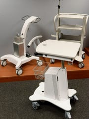Medical carts on display inside the showroom at HUI