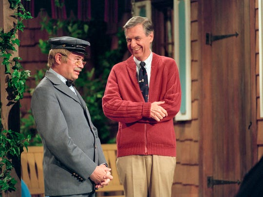 """This image released by Focus Features shows David Newell, as Mr. McFeely, left, and Fred Rogers on the set of """"Mister Rogers' Neighborhood,"""" from the film, """"Won't You Be My Neighbor."""" (Lynn Johnson/Focus Features via AP) ORG XMIT: NYET1188"""
