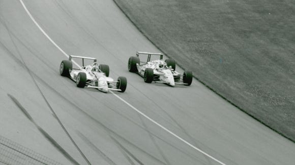 Rick Mears and Michael Andretti used the stretch of pavement below the white line, known as the apron, to stage a thrilling late-race battle in the 1991 Indianapolis 500 Jerry Clark photo