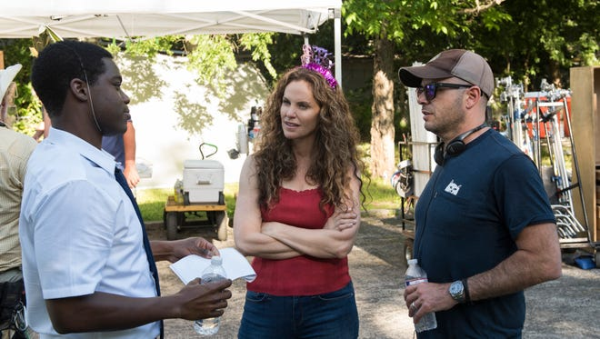 """Damon Lindelof, right, a native of Teaneck, on the set of """"The Leftovers,"""" the show that he co-created for HBO. With him are Jovan Adepo, left, and Amy Brenneman."""