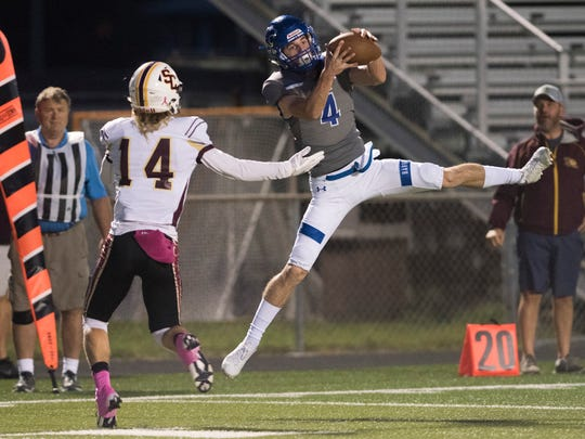Michael Mclay of Barron Collier makes a leaping interception