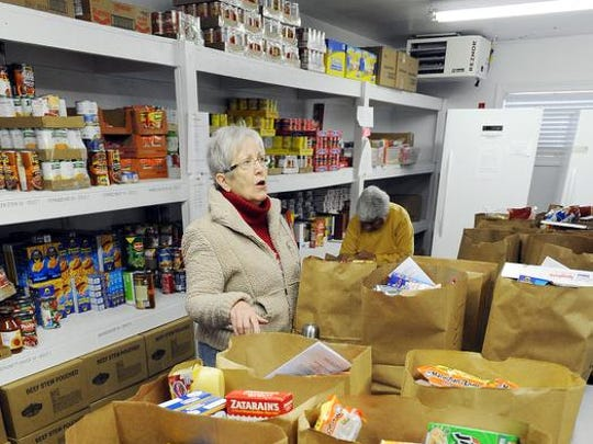 Pat Hudson from Lewes volunteers at the Cape Henlopen Food Basket located off Oyster House Road near Rehoboth Beach.