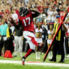 ATLANTA, GA - SEPTEMBER 18:  Wide receiver Devin Hester #17 of the Atlanta Falcons returns a punt for a touchdown against the Tampa Bay Buccaneers during a game at the Georgia Dome on September 18, 2014 in Atlanta, Georgia.  (Photo by Scott Cunningham/Getty Images)
