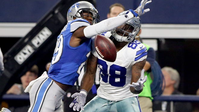 Cowboys wide receiver Dez Bryant (88) catches a touchdown pass past Lions cornerback Johnson Bademosi (29) during the first half of the Lions' 42-21 loss Monday in Arlington, Texas.