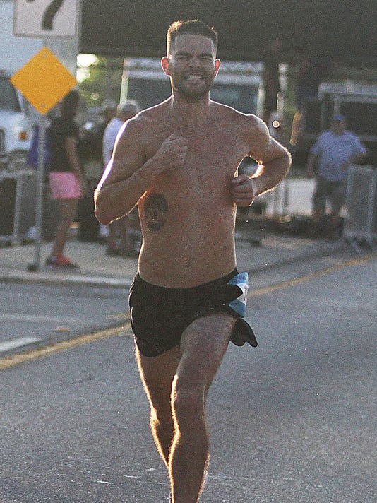 Jordan Mahan, 32, won the male division of the 2018 Fourth of July Freedom 5K run over the Cape Coral Bridge Wednesday morning in Cape Coral.