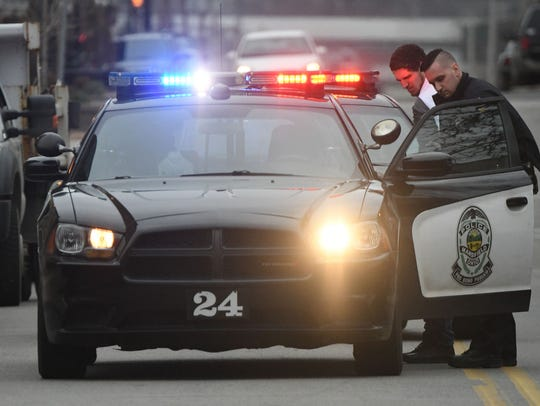 A man is taken into custody by a Mansfield police officer