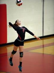 Hattiesburg High senior Jennifer Porceillo serves the ball during a game against Petal High School on Friday.