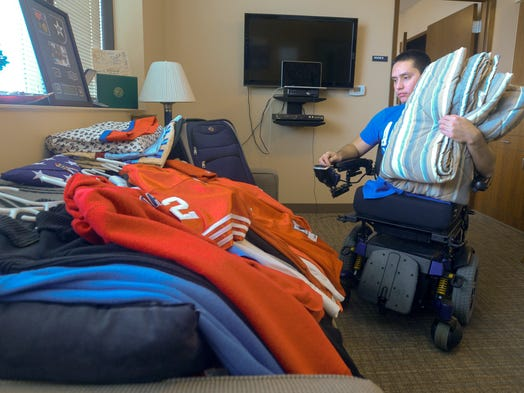 Joseph Grabianowski, 25, gathers his belongings for movers to pack as he prepares to relocate from his quarters at Walter Reed Army Medical Center.
