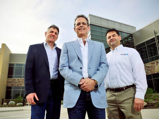 Blattner Energy executives Doug Fredrickson, vice president of strategic initiatives, from left; Scott Blattner, president; and Ken Hilgert, vice president of business development, are shown in a file photo from 2013.