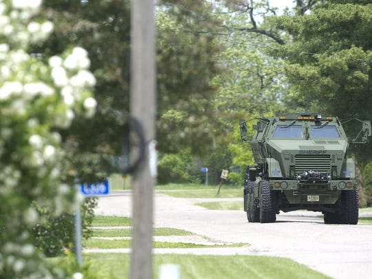 An armored vehicle makes its way down Klondyke Street during a standoff Wednesday in Bancroft.