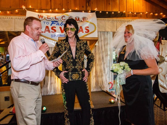 Elvis impersonator Alan Graveen conducts a vow renewal