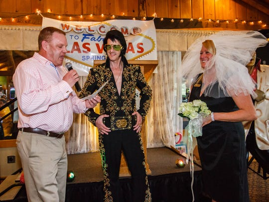 Elvis impersonator Alan Graveen conducts a vow renewal ceremony for Dan and April Reszka during the Viva Las Vegas themed Spring Fling hosted by the Mukwonago Chamber of Commerce at Hawk's View Golf Course in Lake Geneva on Saturday, April 8, 2017. April Reszka is the Executive Director of Mukwongo Area Chamber of Commerce & Tourism Center.