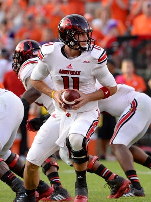 Louisville quarterback Will Gardner takes the snap during an NCAA college football game against Clemson in Clemson, S.C., Saturday, Oct. 11, 2014. Clemson won 23-17. (AP Photo/ Richard Shiro)