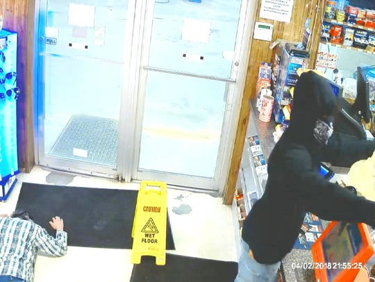 The suspect possibly robbed another convenience store