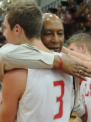 Senior Caleb Green embraces his coach Tuesday night as David Wood takes home his 300th career victory.