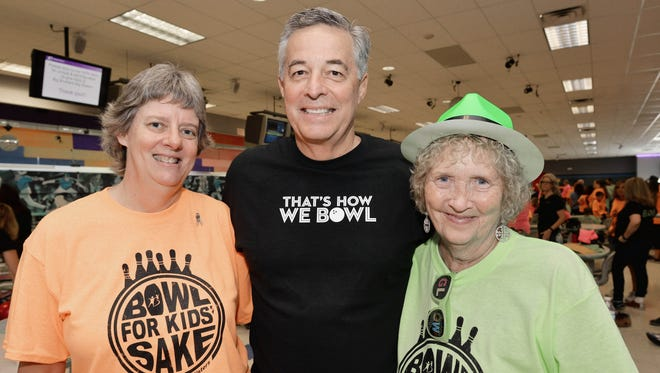 Debbie Hawley, St. Lucie County School Board; Wayne Gent, Honorary Chair/Superintendent of Schools SLC; and Judi Miller, CEO Big Brothers Big Sisters, are ready to 'Glow Crazy' at the annual Bowl for Kids' Sake to benefit Big Brothers Big Sisters of St. Lucie County.