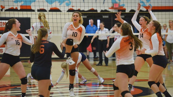 Washington volleyball players celebrate during the game against Lincoln Tuesday at Washington High School.