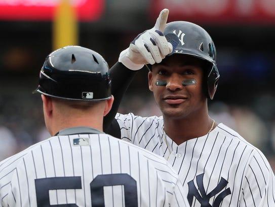New York Yankees' Miguel Andujar motions the crowd