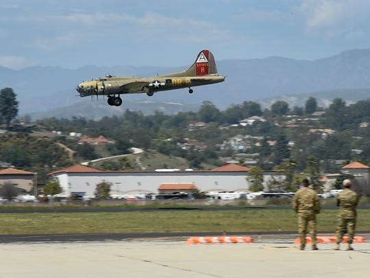 A B-17 bomber lands at the Camarillo Airport on Thursday