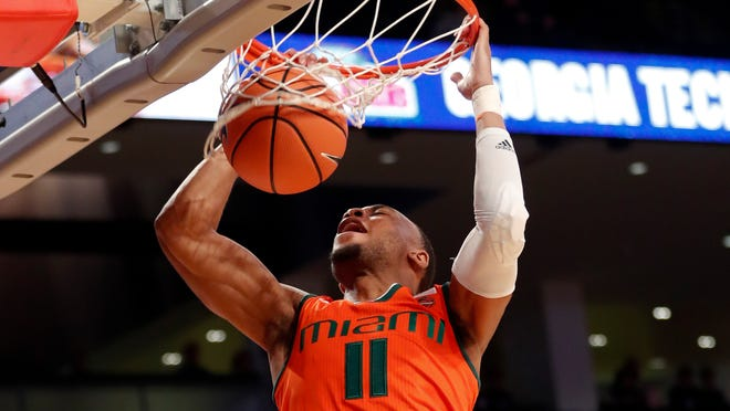 Miami guard Bruce Brown Jr. (11) scores against the Georgia Tech in the first half of an NCAA college basketball game Wednesday, Jan. 3, 2018, in Atlanta. (AP Photo/John Bazemore)