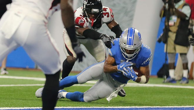 Lions WR Golden Tate catches the ball as Falcons CB Brian Poole touches him and his knee hits the ground on the final play of the Lions' 30-26 loss at Ford Field on Sept. 24, 2017. Originally ruled a touchdown, the play was overturned, ending the game.