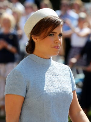 Princess Eugenie, at the wedding of Prince Harry and Duchess Meghan, has shared X-rays depicting her battle with scoliosis.