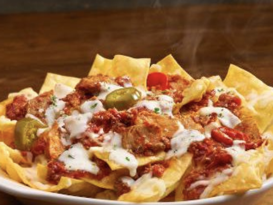 "Olive Garden recently released a new dish called ""loaded pasta chips,"" which are basically Italian nachos."