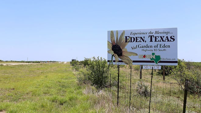 A welcoming sign alerting travelers they are about to enter the City of Eden, about 40 minutes from San Angelo, is visible from U.S. Highway 87 south, June 6, 2018.