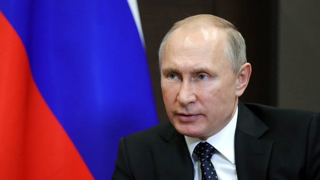 Russian President Vladimir Putin, shown here at the Black Sea resort Sochi, on Nov. 25, 2017 signed into law a news bill designating media outlets as foreign agents.