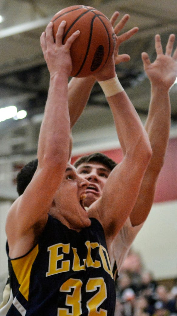 Elco's Colton Lawrence drives to the hoop against Berks