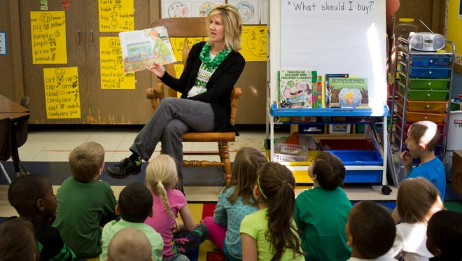 Kindergarten teacher Jennifer Basey reads a St. Patrick's Day-themed book to her class Tuesday at Woodrow Wilson Elementary School in Port Huron.