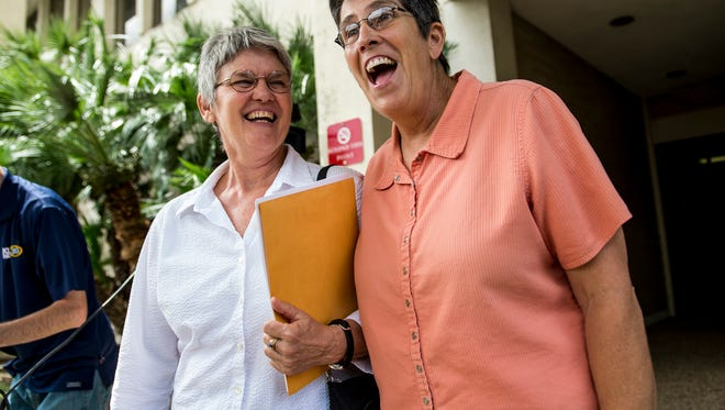 A copule expresses excitement as they exit the Lafayette Parish Courthouse in Lafayette, La., with their marriage license in-hand Monday, June 29, 2015. The Lafayette Parish Clerk of Court's Office began issuing licenses to same-sex couples on Monday afternoon following Friday's Supreme Court decision striking down bans on same-sex marriage across the country.