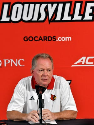 Louisville head football coach Bobby Petrino answers a question during Louisville Media Day, Saturday, Aug. 5, 2017 in Louisville Ky.
