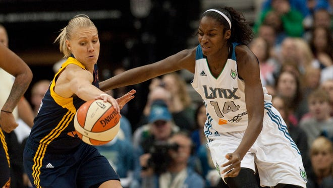 Oct. 14, 2012 - Erin Phillips reaches for a loose ball away from Minnesota Lynx forward Devereaux Peters in Game 1 of the WNBA Finals.