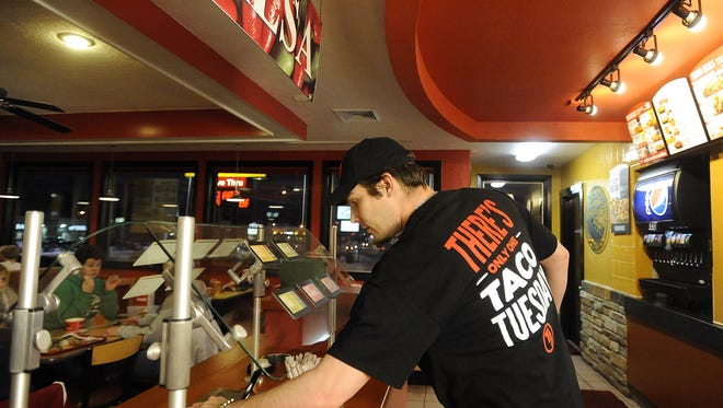James Marken works at Taco John's on Minnesota Avenue in Sioux Falls, S.D., Tuesday, Jan. 19, 2016.